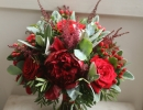 Red wedding bouquet with peonies