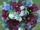 Wedding bouquet of Dahlia, thistles, cornflower and freesia