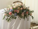 Large, wild ceremony table arrangement