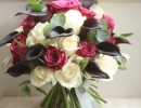 Wedding bouquet with roses and calla lilies