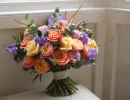 Wide bouquet with roses and sweet peas
