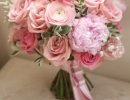 Bouquet with peonies, ranunculus and roses