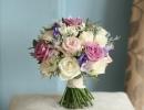 Bouquet of roses, freesia, eustoma and foliage