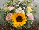 Textured wedding bouquet with sunflowers