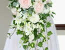 Shower bouquet or roses, dahlia and orchids.