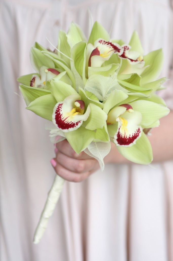 Flower girl posy of green orchids