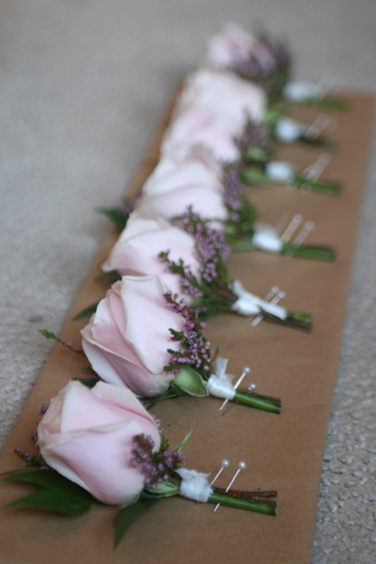 Buttonholes of roses and heather