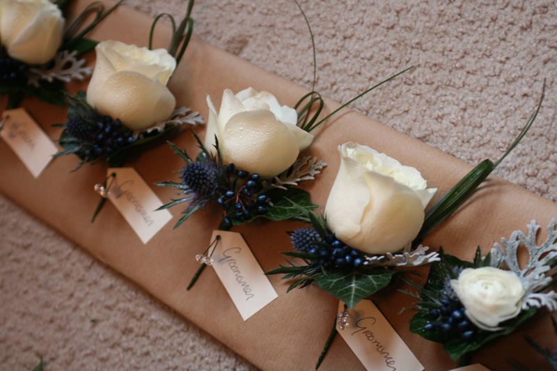 White and midnight blue buttonholes