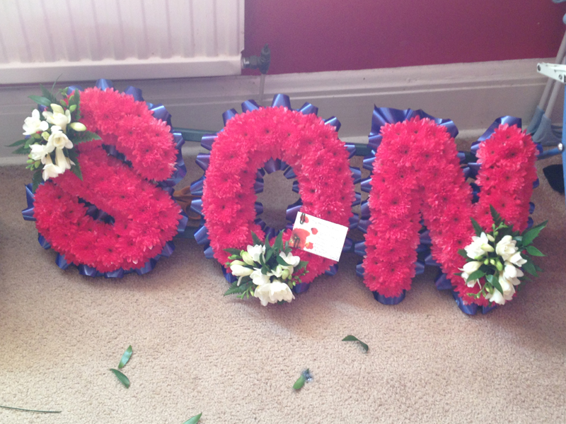 Funeral lettering in red, white and blue