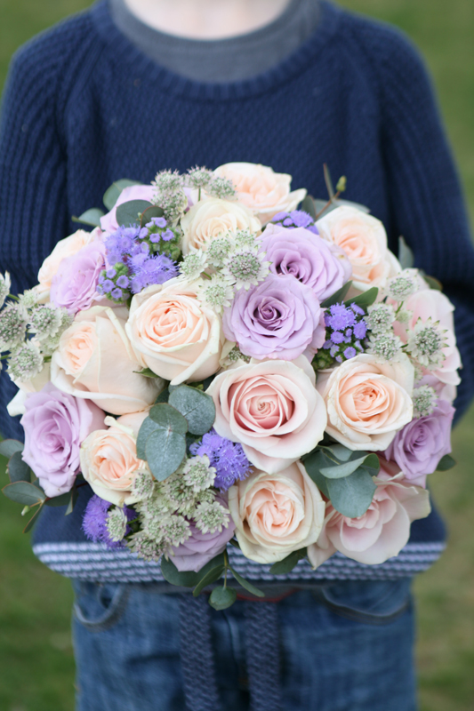 Wedding bouquet in peach, pink and lilac