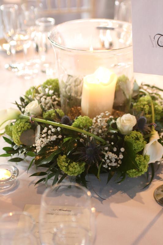 Hurricane vase arrangement with roses, calla lilies, gyp and viburnum