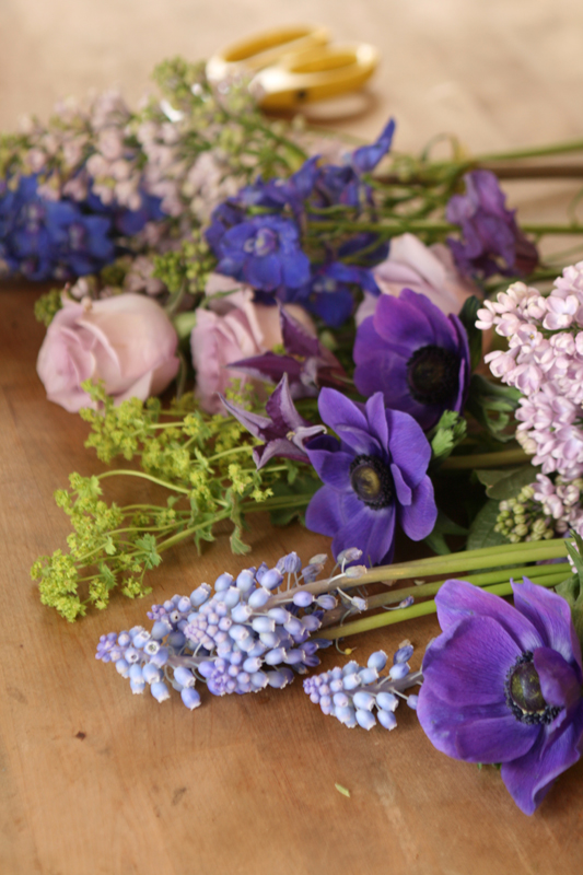 Ingredients of ocean song roses, lilac, delphinium, muscari, anemone and alchemilla.