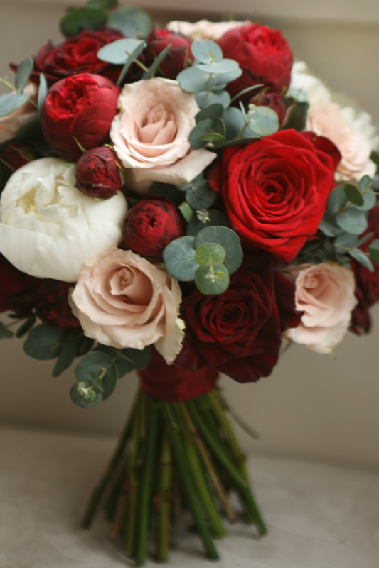 Burgundy, red and champagne coloured bouquet