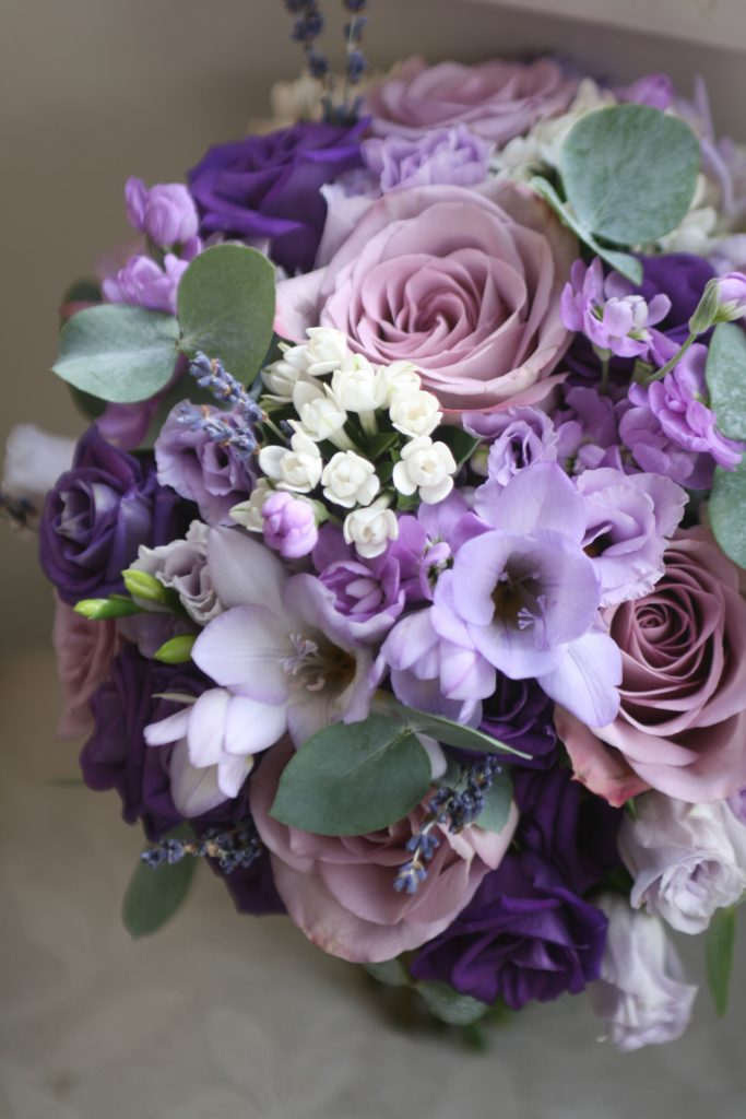 Sarah's bouquet of roses, freesia, eustoma, bouvardia, lavender and eucalyptus.