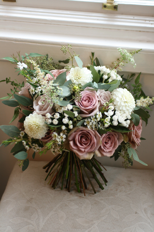 Bouquet of amnesia roses, mentha roses, dahlia, bouvardia, waxflower, astilbe, amme, jasmine and eucalyptus