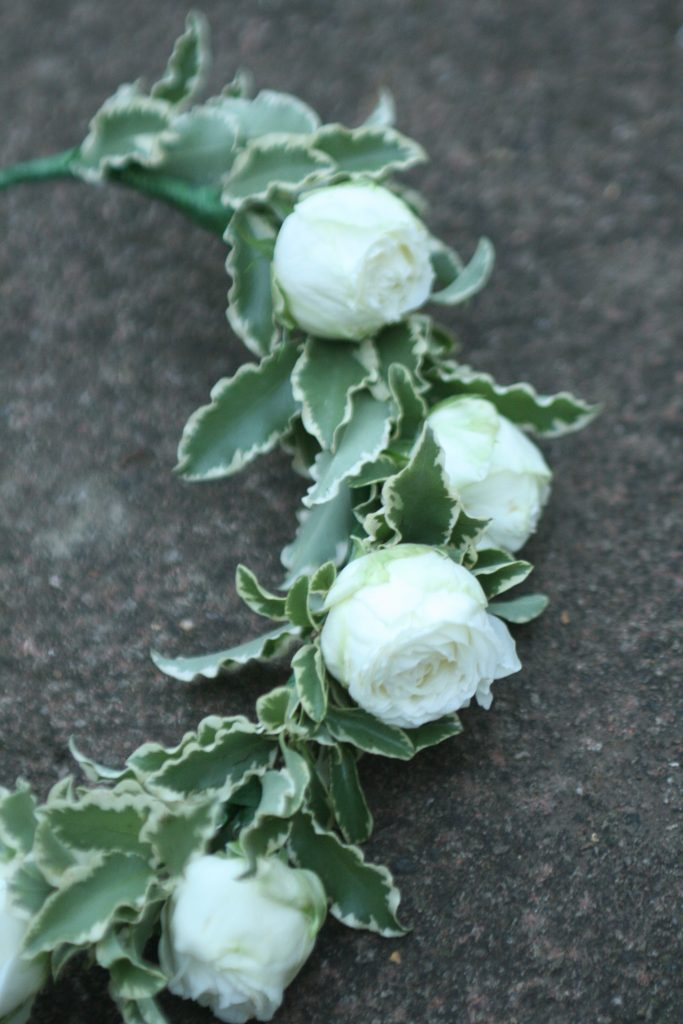 Kate's hair flowers with pitto foliage and lovely white spray roses.