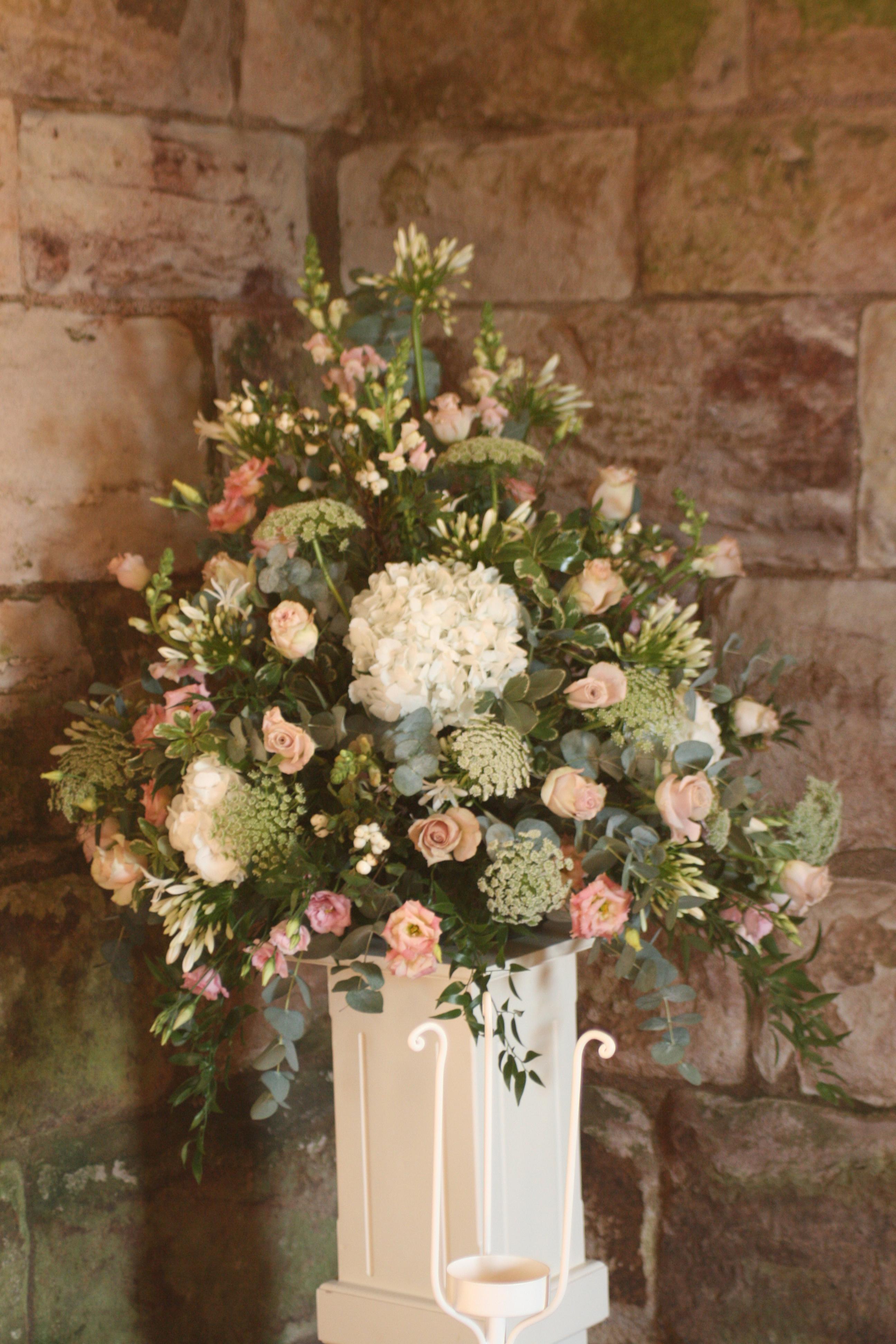 Pedestal arrangement of roses, ammi, hydrangea, eustoma, allium and foliage